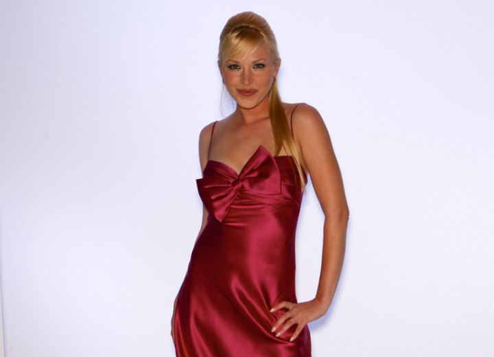 Adrienne Frantz wearing a pink satin dress