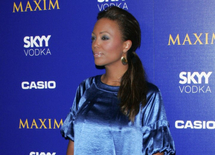 Aisha Tyler wearing a shimmery blue dress