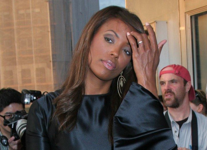 Side view of Aisha Tyler's long hairstyle