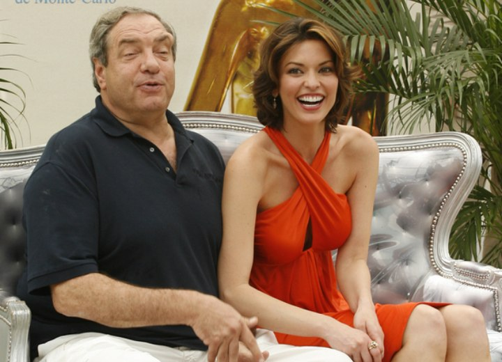 Alana De La Garza wearing an orange dress - With Dick Wolf