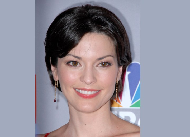 Alana De La Garza wearing her hair styled up with a bun