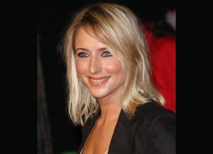 Side view of Ali Bastian's shoulder long hairstyle