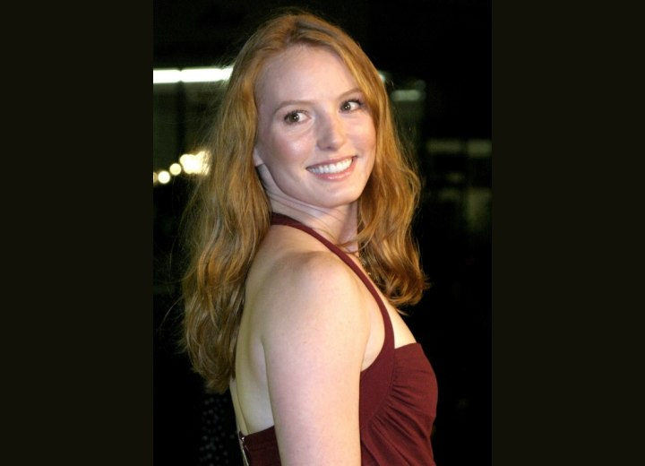 Side view of Alicia Witt's long hairstyle