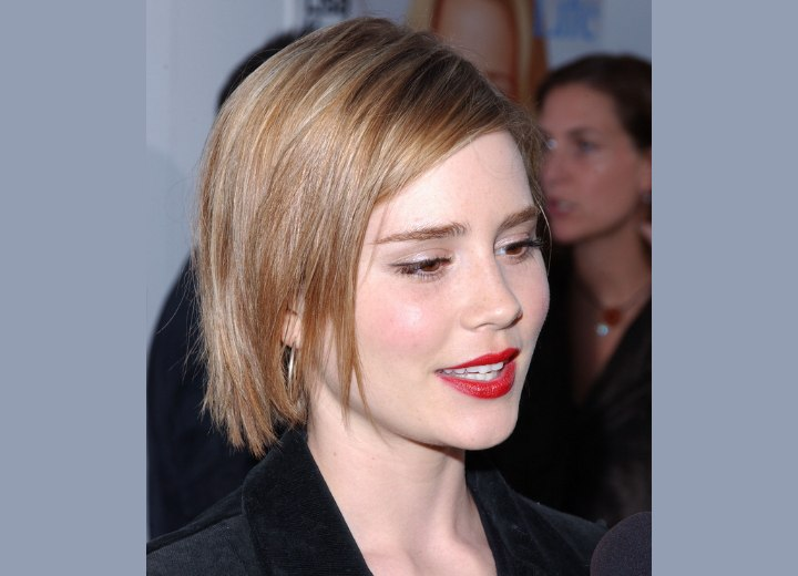 Hair cut in a side-parted bob with a slightly choppy look for Alison Lohman