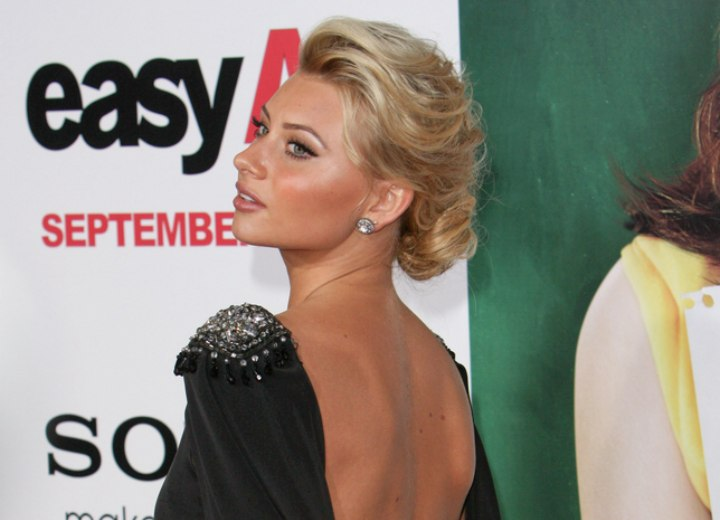 Aly Michalka wearing a black dress with an open back