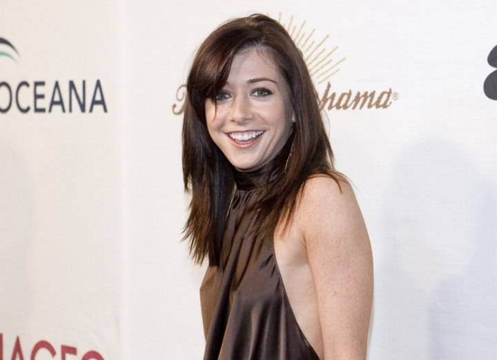 Alyson Hannigan's long hairstyle with a side-swept fringe