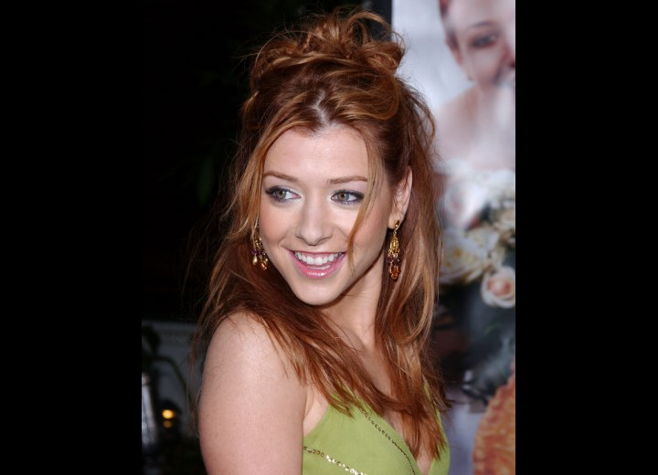 Alyson Hannigan wearing her hair in a partial updo