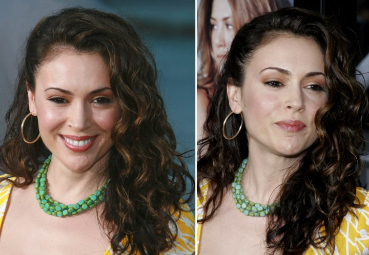 Alyssa Milano wearing her long hair styled on the side