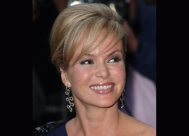 Amanda Holden wearing her hair up in a style with thin bangs