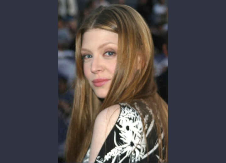 Amber Benson with long hair covering one of her cheeks