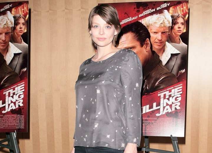 Amber Benson wearing a gray silk top