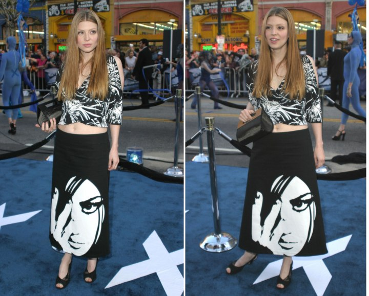 Amber Benson wearing a black and white skirt and top
