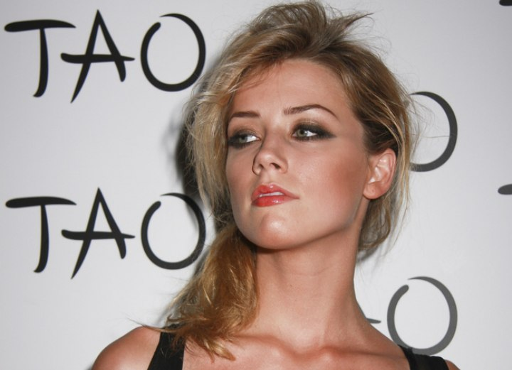 Amber Heard - Messy hairstyle with a loosely tied ponytail