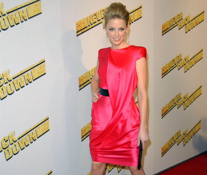 Amber Heard wearing a short fuchsia satin dress