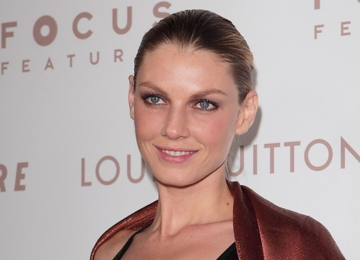 Angela Lindvall with her hair styled sleek and backwards