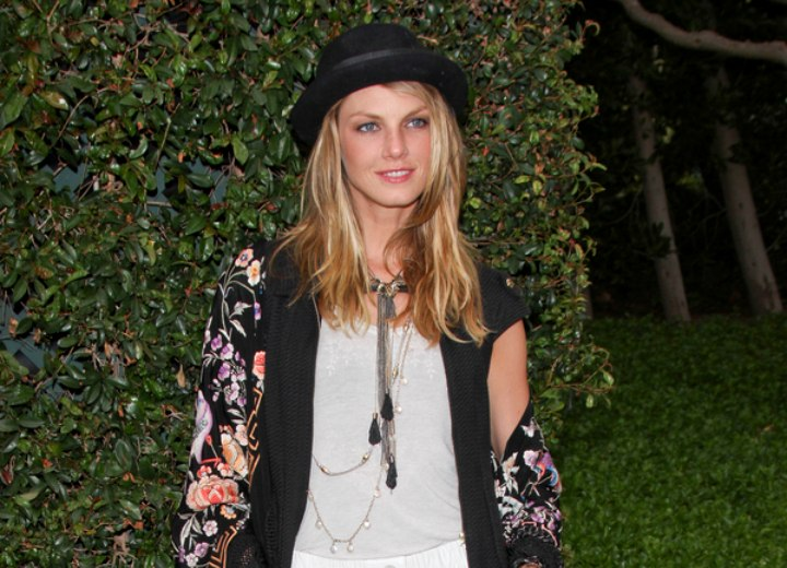 Angela Lindvall wearing a short skirt and a large shawl