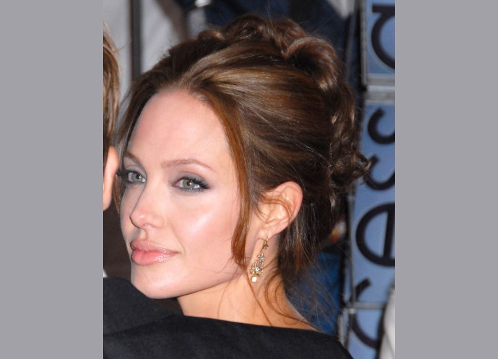 Angelina Jolie with her hair pulled back and styled up