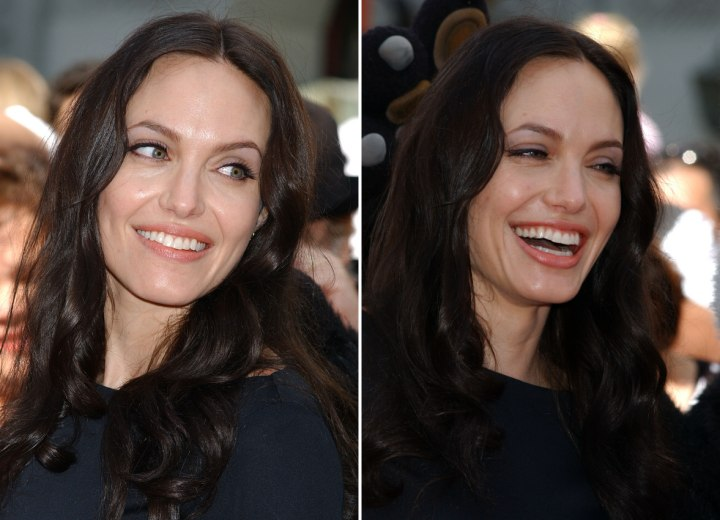 Angelina Jolie's dark long hairstyle with waves