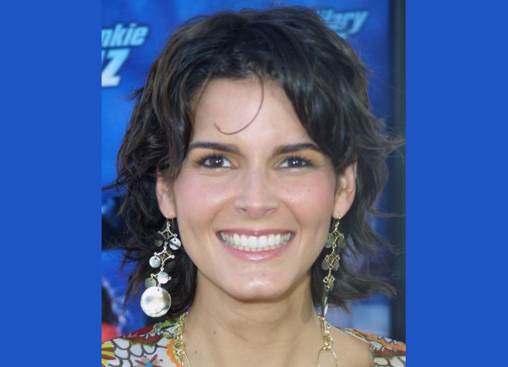 Angie Harmon - Medium hairstyle styled loose and ruffled