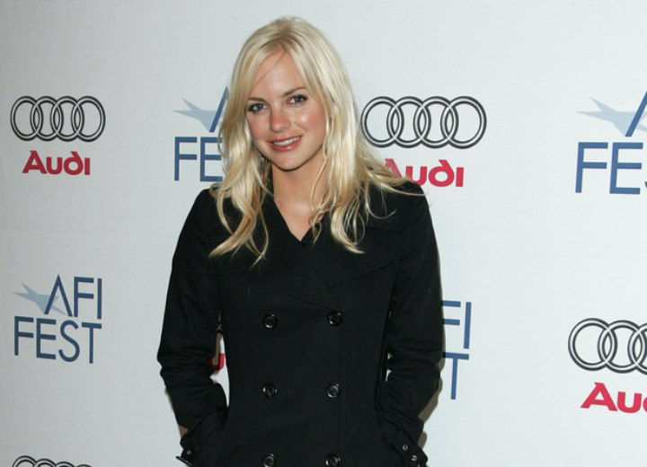 Anna Faris wearing a black trench coat