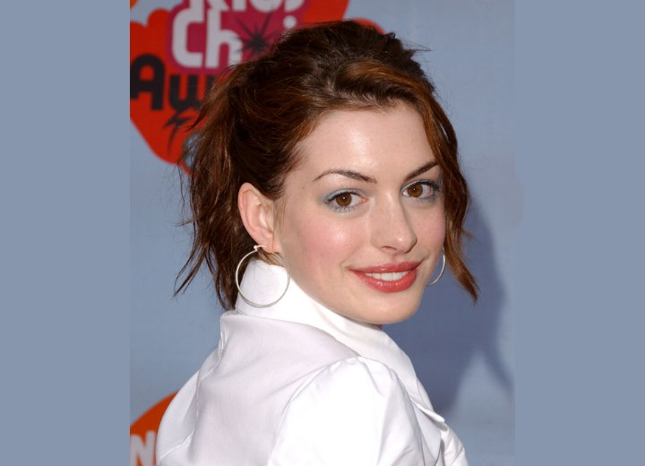 Anne Hathaway wearing her hair pulled back