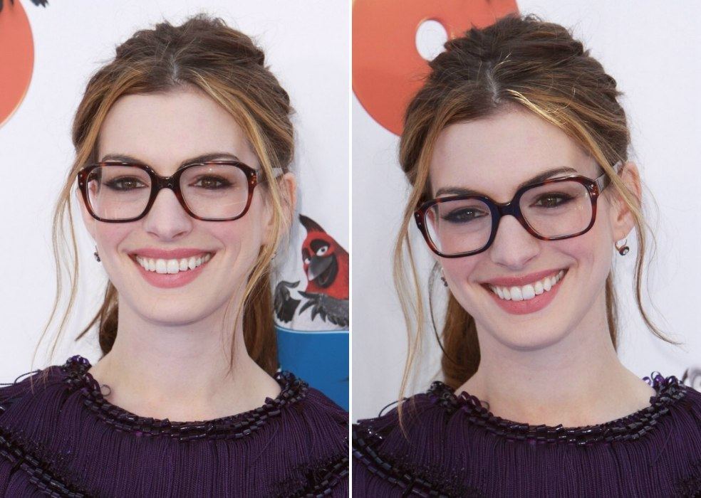Anne Hathaway Wearing Large Glasses And With Her Hair In A Thick Ponytail