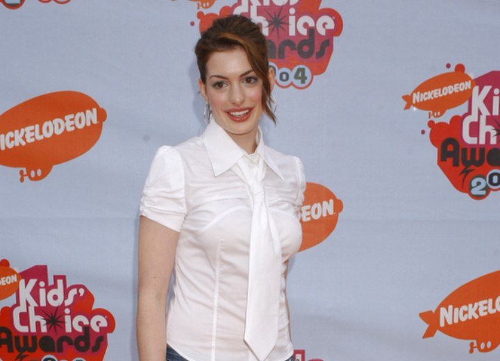 Anne Hathaway wearing a white blouse and jeans