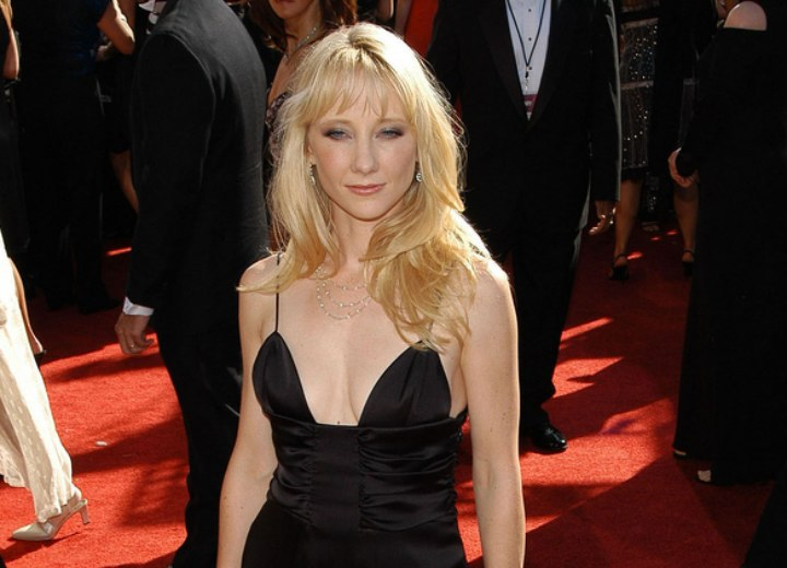 Anne Heche wearing a spaghetti strap evening gown