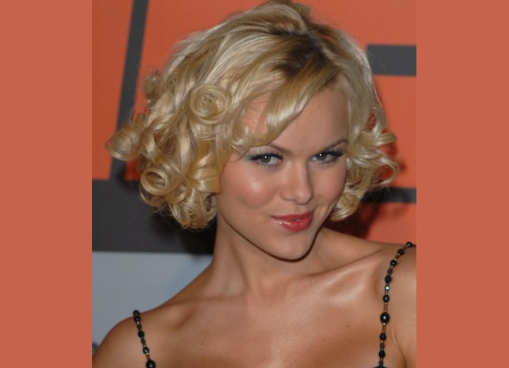Anya Monzikova with short curled hair