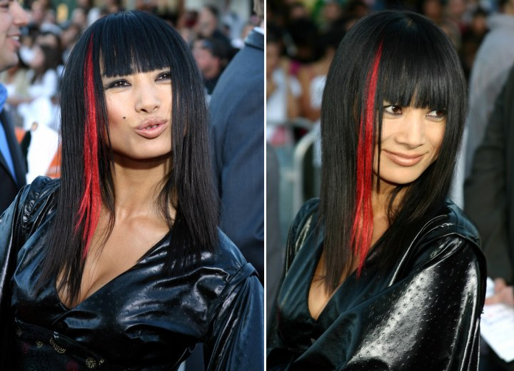 Straight black hair with red brush-on hair color for a dramatic look