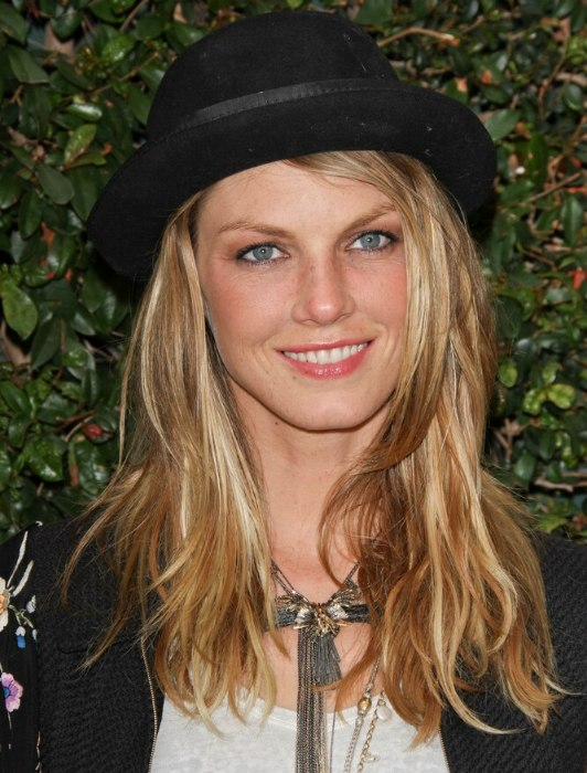 Angela Lindvall With Long Blonde Hair And Wearing A Bowler
