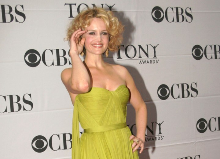 Carla Gugino with blonde hair and curls