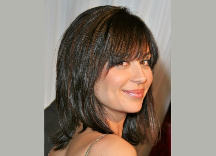 Catherine Bell wearing her hair in a long smooth bob - Side view