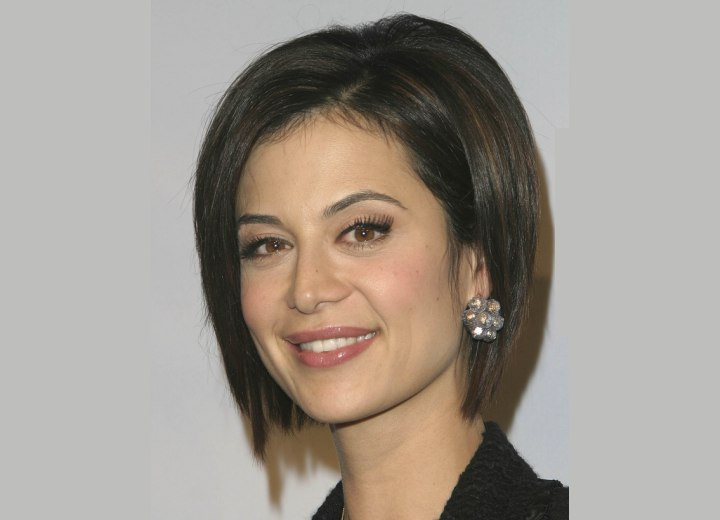 Catherine Bell with her hair cut into a lifted bob