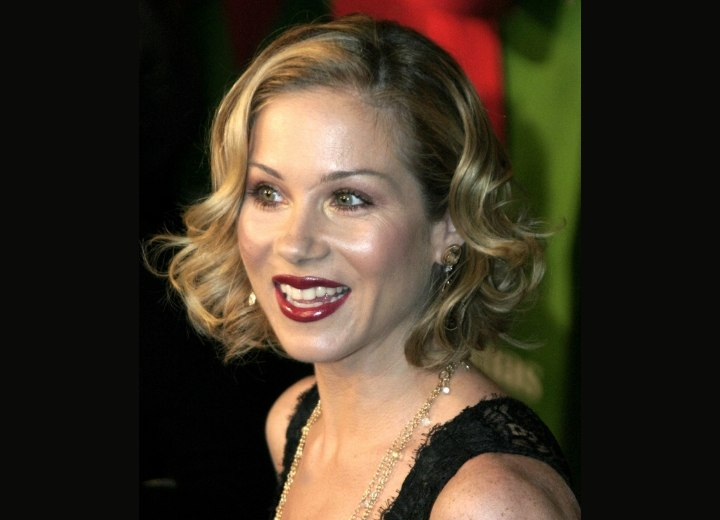 Christina Applegate wearing her hair short with barrel curls
