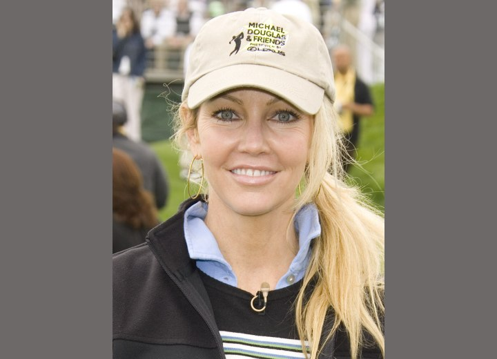Heather Locklear wearing a polo shirt with the collar up