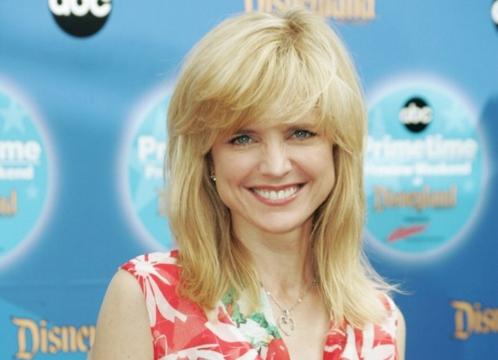 Courtney Thorne-Smith - Long hairstyle with feathered bangs