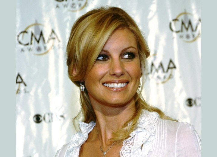 Faith Hill wearing her hair tied back