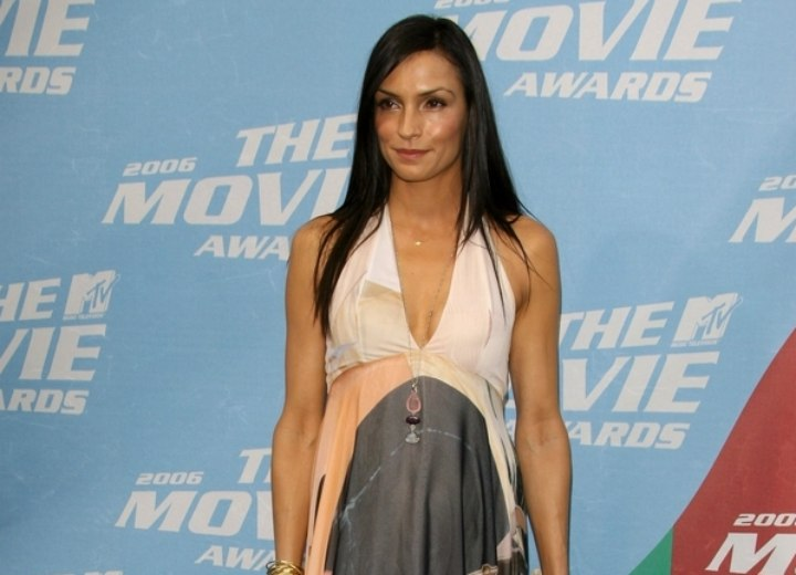 Famke Janssen wearing a colorful long dress