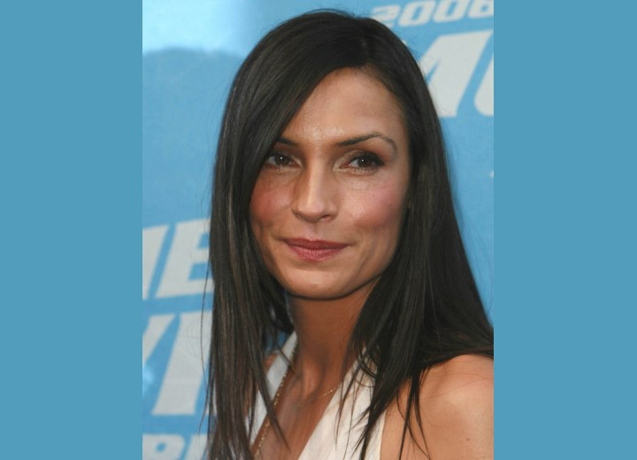 Famke Janssen wearing her hair long and around her shoulders