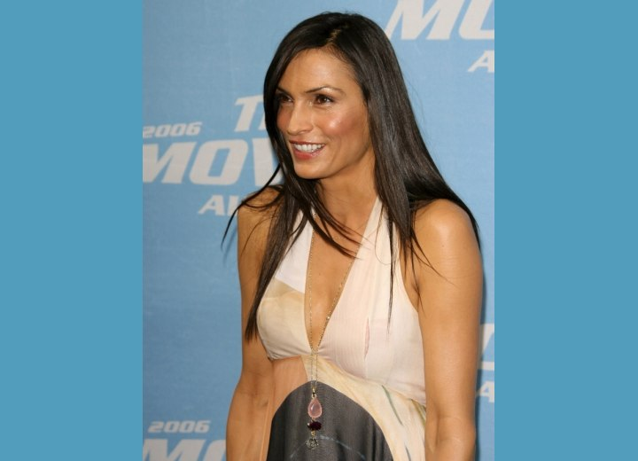 Famke Janssen wearing her hair long and sleek