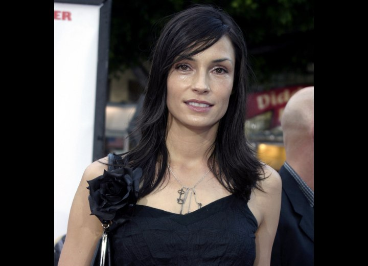 Famke Janssen - Classic long and versatile hairstyle