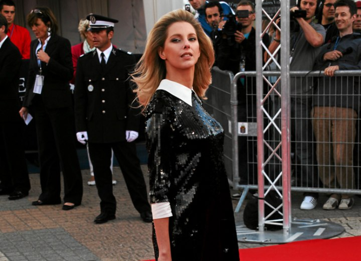Frederique Bel wearing a black dress with sequins