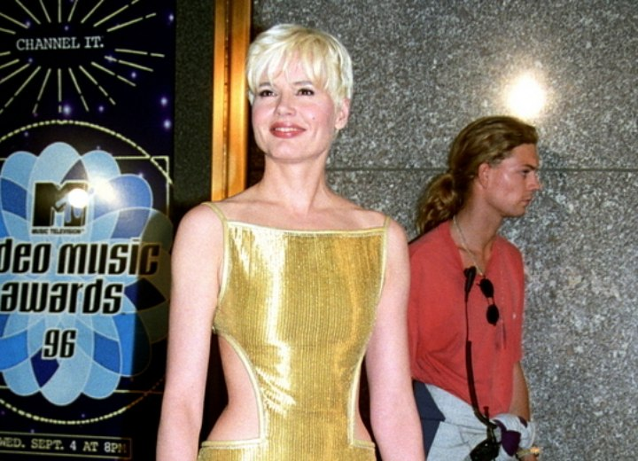 Geena Davis with short platinum blonde hair