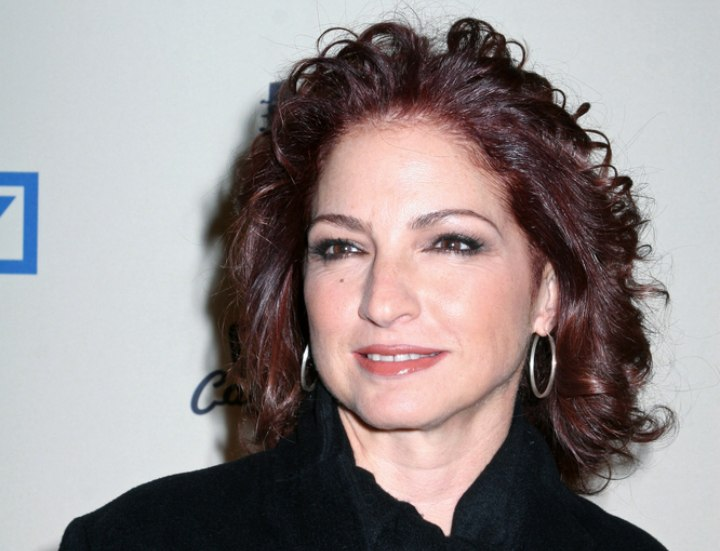 Gloria Estefan Shoulder Long Hairstyle With Curls And Red Highlights