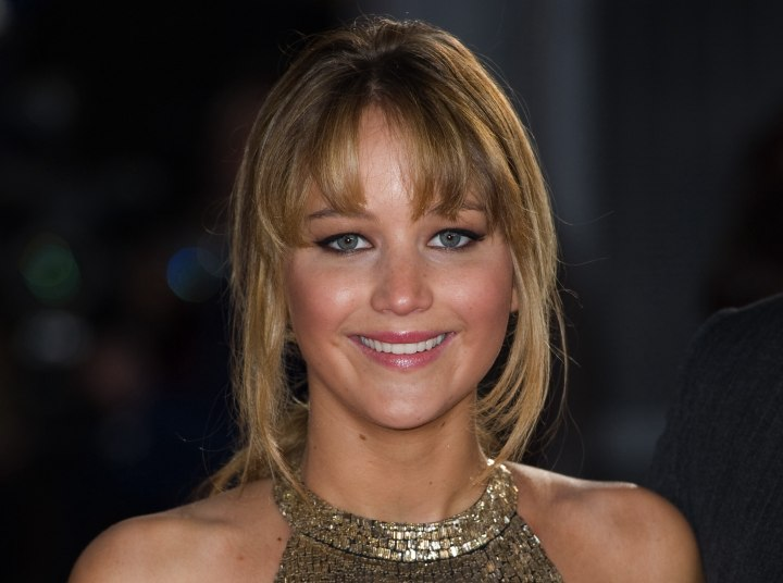 Jennifer Lawrence wearing her hair in an up-style with bun