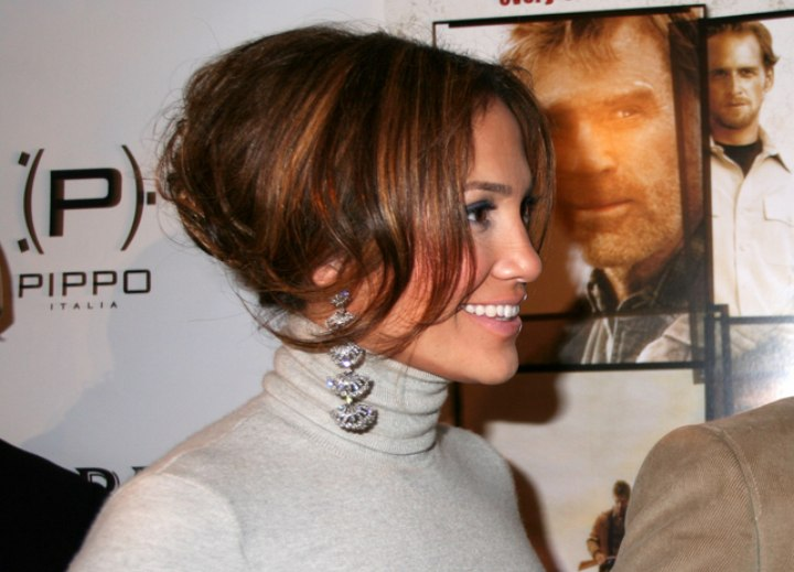 Jennifer Lopez with her hair up and wearing a turtleneck