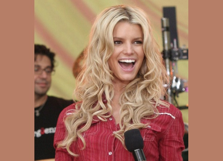 Jessica Simpson with very long hair and curls