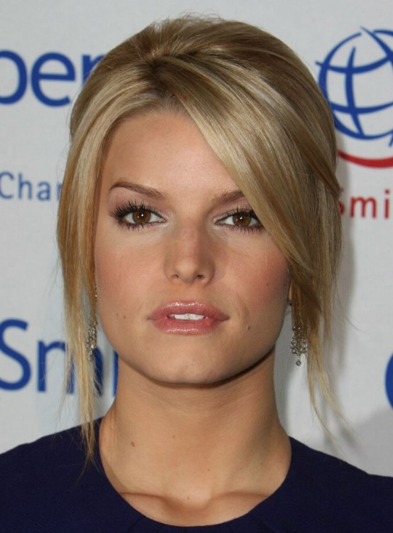 Jessica Simpson 60s Fashion Low Ponytail With Hair Wrapped Around It