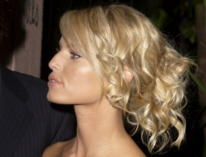 Side view of Jessica Simpson's curly up-style
